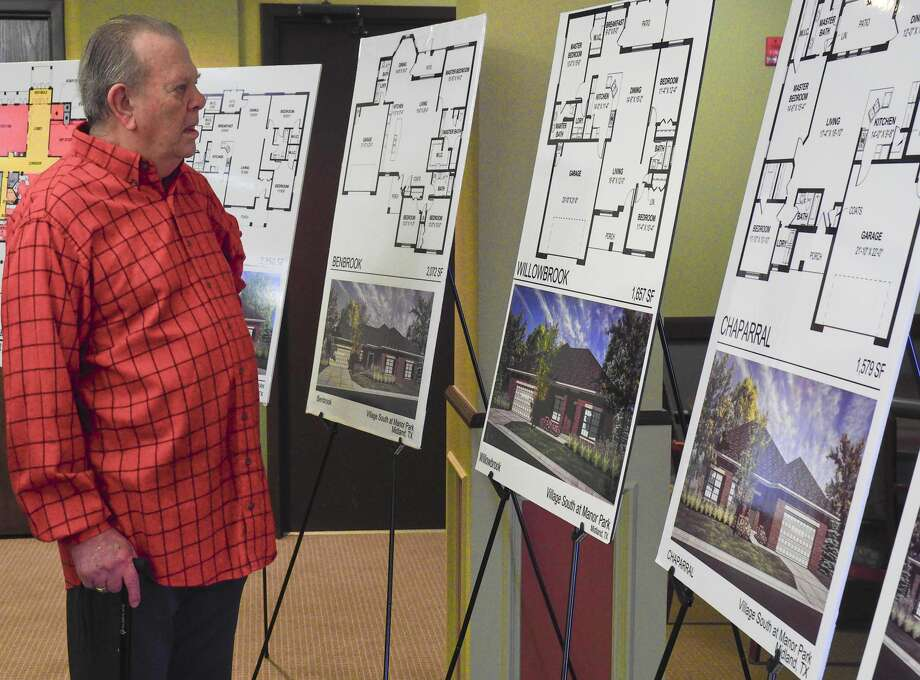 Don Byerly looks at some of the floor plans available 11/02/17 during the kickoff at Manor Park of the new Village South development. Tim Fischer/Reporter-Telegram Photo: Tim Fischer/Midland Reporter-Telegram