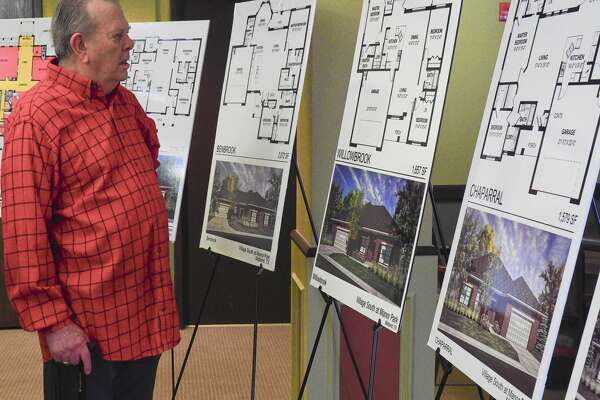 Don Byerly looks at some of the floor plans available 11/02/17 during the kickoff at Manor Park of the new Village South development. Tim Fischer/Reporter-Telegram