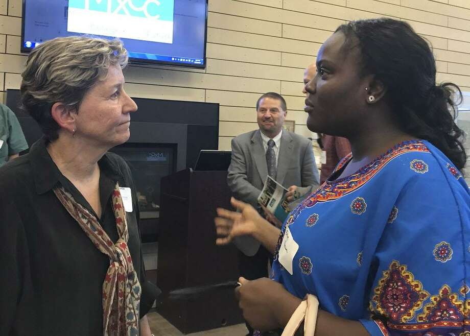 Robin Gilmartin of West Hartford, left, who received a Middlesex Community College Foundation donor recognition award recently, talks to Evelyn Mireku of Meriden, right, who received funding in the past. Photo: Contributed Photo
