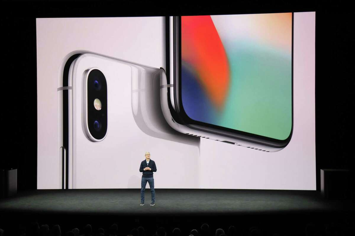 Tim Cook, Apple's chief executive, introduces the iPhone X at the new Steve Jobs Theater in Cupertino, Calif. Sept. 12. 2017. Apple and several of the biggest U.S. companies would no longer be able to escape taxes on the trillions in overseas profits they've accumulated, under a tax bill released by House Republicans on Thursday.