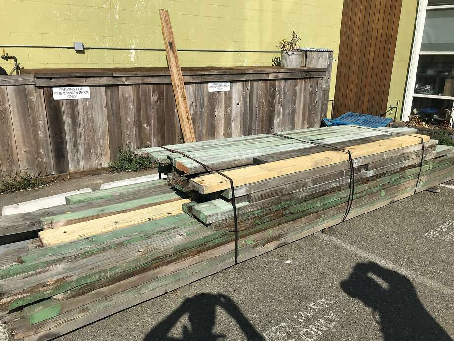 A load of seat benches from Memorial Stadium awaiting sale at the Wooden Duck in Berkeley Photo: Sam Whiting