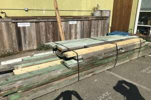 A load of seat benches from Memorial Stadium awaiting sale at the Wooden Duck in Berkeley
