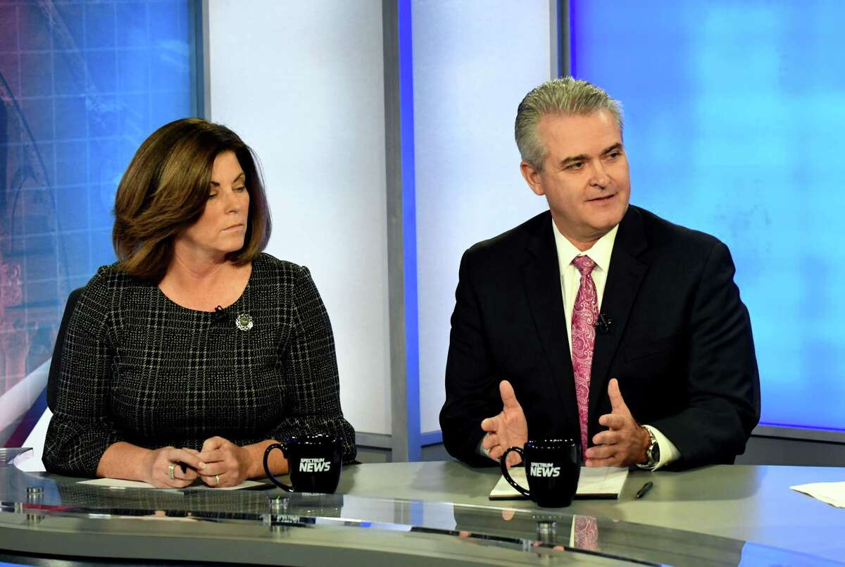 Candidates for Rensselaer County Executive; Democrat Andrea Smyth, left, and Republican Assemblyman Steven McLaughlin, right, take part in a debate at Spectrum News on Thursday, Nov. 2, 2017, in Albany, N.Y. (Will Waldron/Times Union)