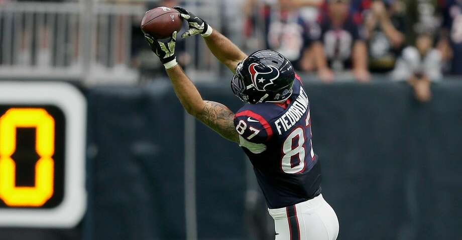 Texans tight end C.J. Fiedorowicz said he was considering retirement but has not decided yet. He plans to attend OTAs in April. Photo: Bob Levey/Getty Images