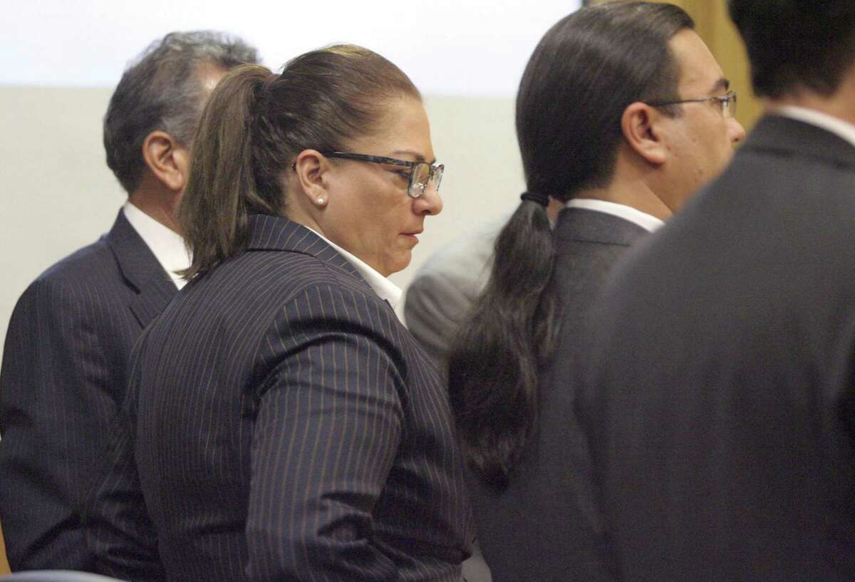 Monica Patterson listens as the guilty verdict is read in her capital murder trial at the Hidalgo County Court house 370th state District Court on Wednesday, Nov. 1, 2017, in Edinburg, Texas. Patterson, the former administrator of a South Texas hospice, was convicted of capital murder and other theft and misuse of funds charges in the January 2015 death of 96-year-old Martin Knell, whose estate she controlled. (Delcia Lopez//The Monitor via AP)