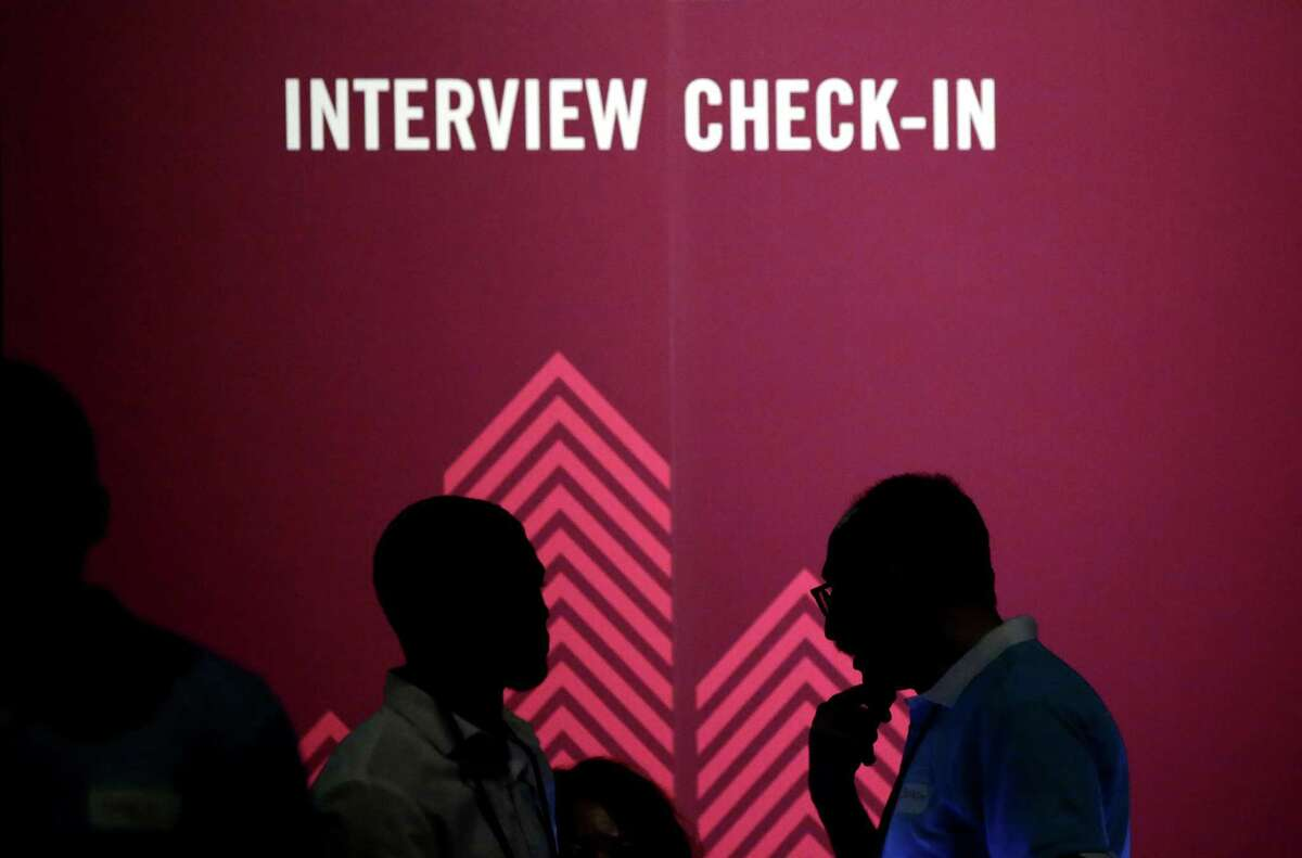 Job seekers chat during the Opportunity Fair and Forum employment event in Dallas in May. An Associated Press-CNBC poll found that half of all Americans who've ever applied for a job have been asked questions that could be used to discriminate.