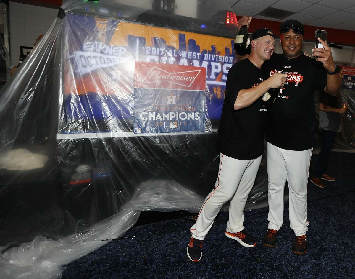 Houston Astros manager A.J. Hinch with assistant hitting coach Alonzo Powell in the clubhouse after they clinched the American League West crown after beating the Seattle Mariners 7-1 during an MLB baseball game at Minute Maid Park, Sunday, Sept. 17, 2017, in Houston. ( Karen Warren / Houston Chronicle )