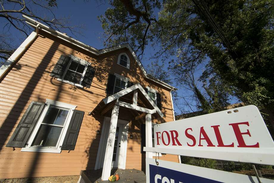 This Tuesday, Oct. 17, 2017, photo shows a home for sale in Fort Washington, Pa. On Thursday, Oct. 19, 2017, Freddie Mac reports on the week's average U.S. mortgage rates. (AP Photo/Matt Rourke) Photo: Matt Rourke, Associated Press