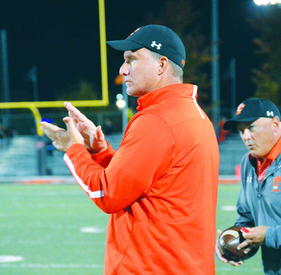 EHS coach Matt Martin applauds his team during a Week 9 game against Collinsville.