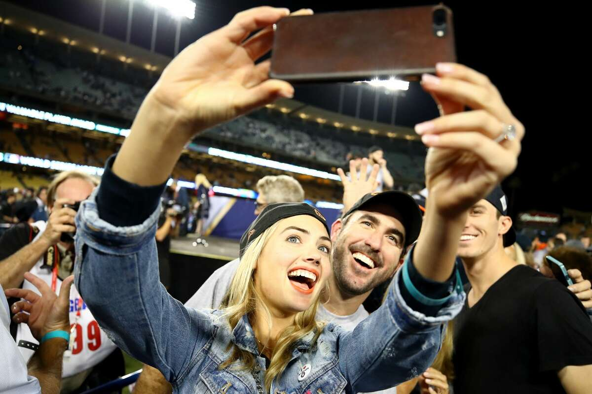 Justin Verlander #35 of the Houston Astros takes a picture with fiancee Kate Upton after the Astros defeated the Los Angeles Dodgers 5-1 in game seven to win the 2017 World Series at Dodger Stadium on November 1, 2017 in Los Angeles, California.