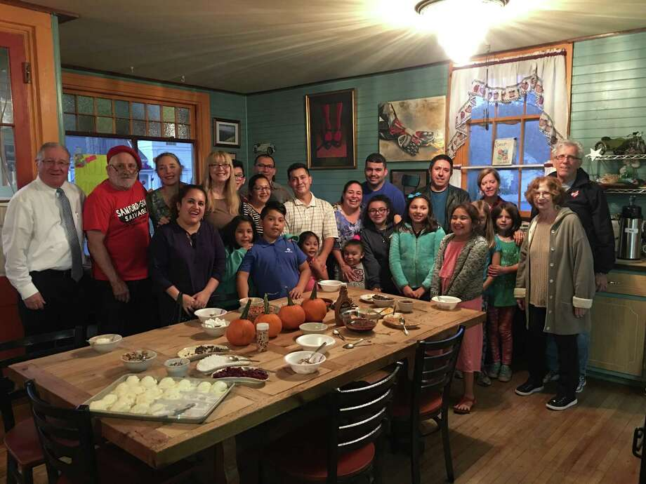 Standing, from left, are Owen Quinn, United Way Northwest Ct; Greg Bidou, Toymakers Cafe, Ann Bidou, Toymakers Cafe; Blanca Penaranda CAFTA parent;Teresa Graham Sullivan, CAFTA; Luis, Ermal Panaranda, Rose Tapia, Jose Borja, The Medina Family; Pedro Rivera; Nicole BastianseFritch and Avalee, Natalie and Julian Goldsmith, CAFTA Advisory Committee. Front row, from left, are Blanca Penaranda, CAFTA parent, and CAFTA students Zalisha, Henry, Yarlee, Tari, Elizabeth, Daniella. Photo: Photo By John Sullivan /Not For Resale