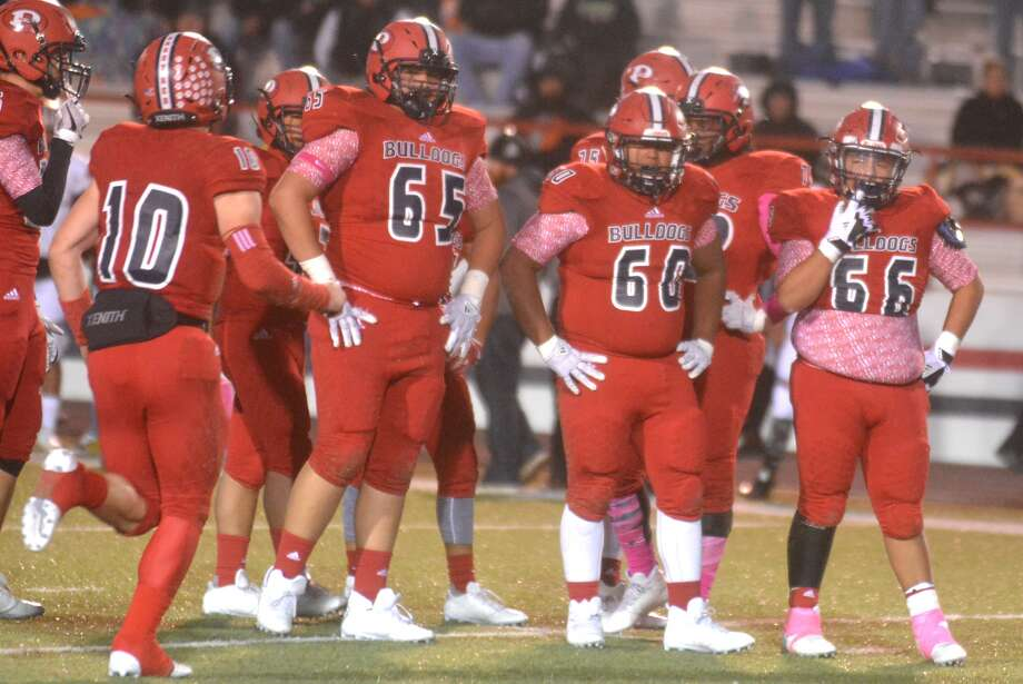 Plainview quarterback Carson Hauk, 10, runs to the huddle to call the next play during last week's game against Caprock. Awaiting the play are offensive linemen, from left, Edgar Quiroga, 65, Octavius Vera, 60, and Adrian Ramirez, 66. Photo: Skip Leon/Plainview Herald