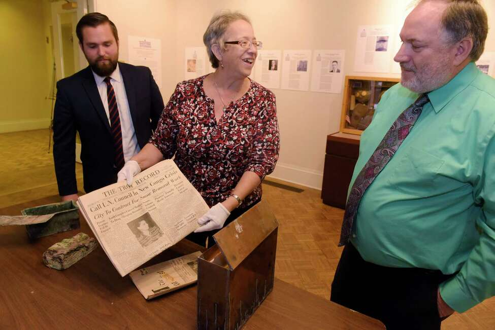 Greg Eves, left, marketing and PR coordinator with United Group of Companies, Kathy Sheehan, center, Troy and Rensselaer County historian, and Rensselaer County Historical Society registrar, and Tim Haskins, project manager with United Group of Companies, look over items that were inside time capsules from the former Immaculate Conception seminary on on Thursday, Nov. 2, 2017, in Troy, N.Y. (Paul Buckowski / Times Union)