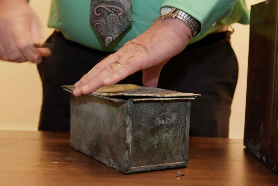Tim Haskins, project manager with United Group of Companies, removes screws from a copper time capsule box at the Rensselaer County Historical Society on Thursday, Nov. 2, 2017, in Troy, N.Y. The time capsule was in a stone in a building that was the former Immaculate Conception seminary. The College Suites at Hudson Valley was built on the site. (Paul Buckowski / Times Union)