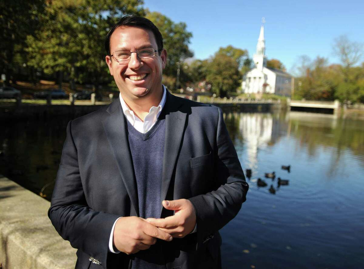 Milford Democratic Mayor Ben Blake is running unopposed for a fourth term outside City Hall in Milford, Conn. on Tuesday, October 31, 2017.