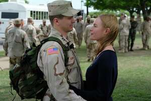 """The Long Road Home"" a tale of love and war. Here, Capt.Troy Denomy (Jason Ritter) and his wife, Gina (Kate Bosworth) say goodbye at Fort Hood, where where all eight hours of the National Geographic series were filmed."