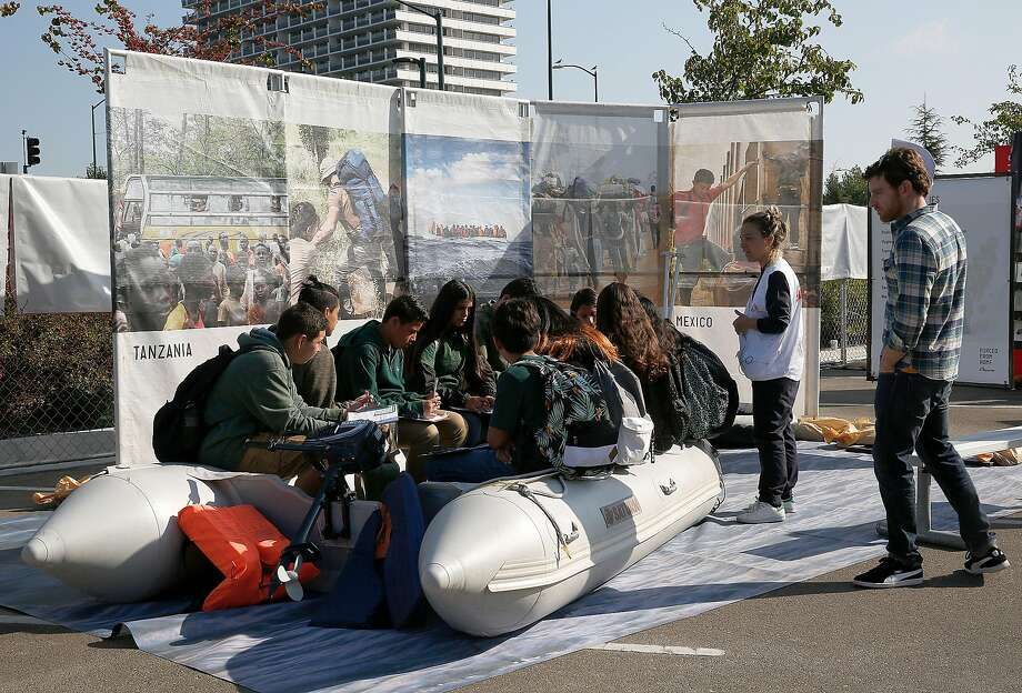 "Students from the Lighthouse Community Charter School visit ""Forced From Home,"" an interactive outdoor exhibition about the global refugee crisis at the Henry J Kaiser Convention Center parking lot on Tuesday, October 31, 2017, in Oakland, Calif. Photo: Liz Hafalia, The Chronicle"
