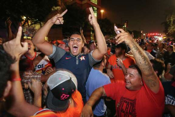Houston Astros fans celebrate after the Astros defeated the Los Angeles Dodgers in the World Series Wednesday, Nov. 1, 2017, in Houston. ( Godofredo A. Vasquez / Houston Chronicle )