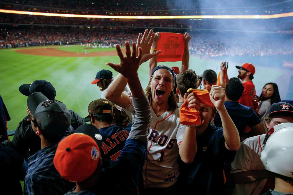 Fans celebrate after the tenth inning as the Houston Astros beat the Los Angeles Dodgers 13-12 in Game 5 of the World Series at Minute Maid Park Monday, Oct. 30, 2017 in Houston. ( Michael Ciaglo / Houston Chronicle)