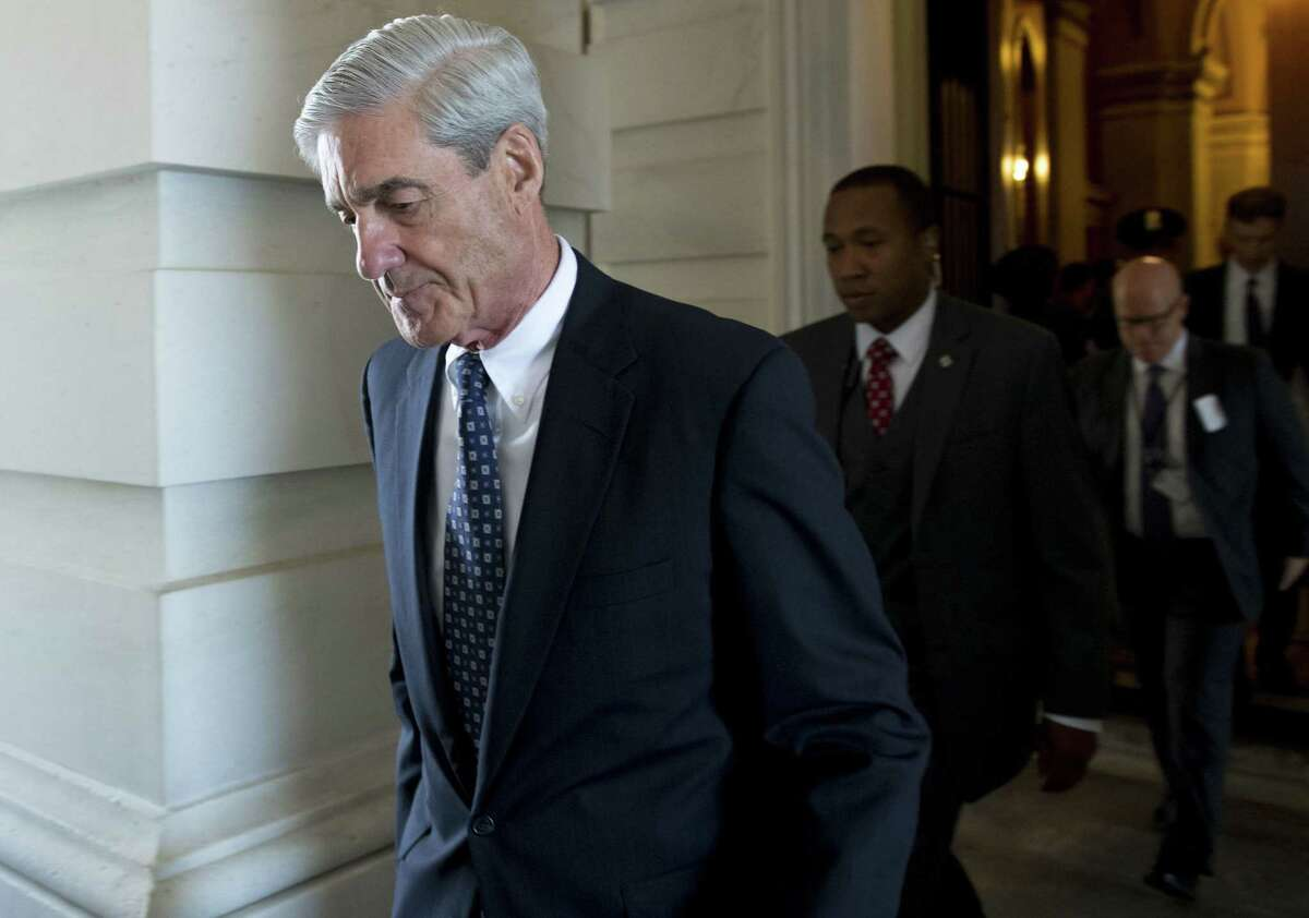 (FILES): This file photo taken on June 21, 2017 shows former FBI Director Robert Mueller, special counsel on the Russian investigation, leaving following a meeting with members of the US Senate Judiciary Committee at the US Capitol in Washington, DC A Washington grand jury on Friday, October 27, 2017 approved the first charges in the probe led by independent prosecutor Robert Mueller, CNN reported, citing sources briefed on the matter. The approval of the charges -- details of which remain unclear -- would mark a major step forward in the sweeping investigation into potential links between US President Donald Trump's campaign and Russian interference in the 2016 US presidential vote. / AFP PHOTO / SAUL LOEBSAUL LOEB/AFP/Getty Images