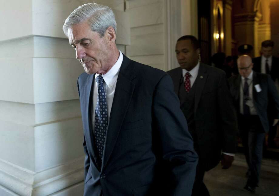 (FILES): This file photo taken on June 21, 2017 shows former FBI Director Robert Mueller, special counsel on the Russian investigation, leaving following a meeting with members of the US Senate Judiciary Committee at the US Capitol in Washington, DC A Washington grand jury on Friday, October 27, 2017 approved the first charges in the probe led by independent prosecutor Robert Mueller, CNN reported, citing sources briefed on the matter. The approval of the charges -- details of which remain unclear -- would mark a major step forward in the sweeping investigation into potential links between US President Donald Trump's campaign and Russian interference in the 2016 US presidential vote.  / AFP PHOTO / SAUL LOEBSAUL LOEB/AFP/Getty Images Photo: SAUL LOEB / AFP/Getty Images / AFP or licensors