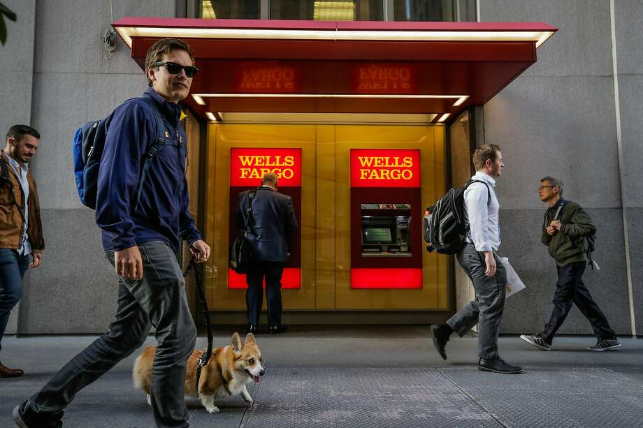People walk past a Wells Fargo ATM machine and bank on California Street in downtown San Francisco , Calif., on Thursday, Sept. 14, 2017. Photo: Gabrielle Lurie, The Chronicle