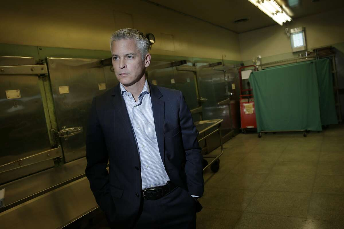 San Francisco Chief Medical Examiner Michael Hunter stands in the morgue during an interview at the Hall of Justice on Wednesday, November 18, 2015 in San Francisco, Calif.