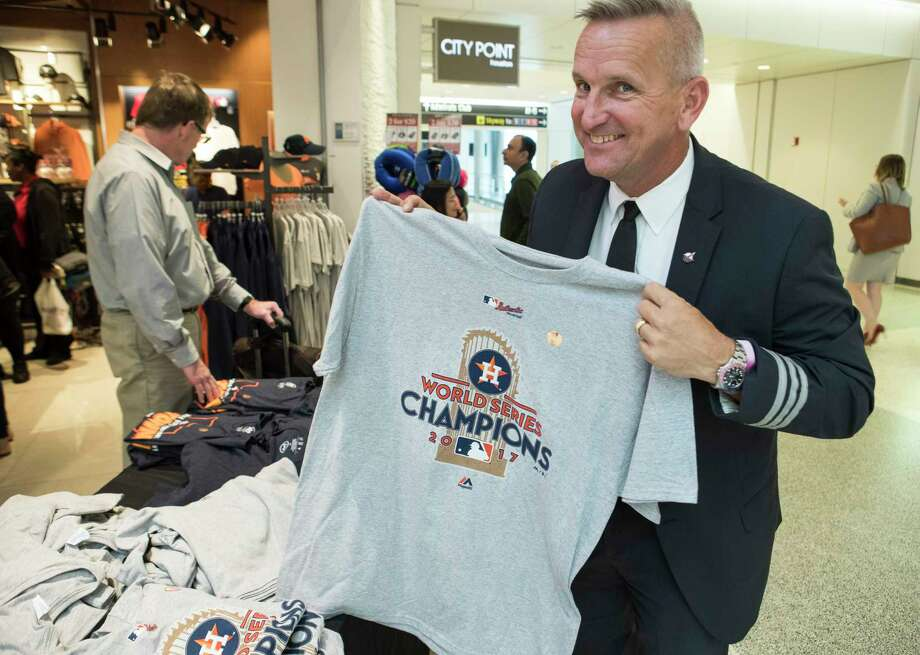 Rick Giles, an American Airlines pilot from North Carolina, shows off a Houston Astros World Series Champions t-shirts while shopping in the A terminal at George Bush Intercontinental Airport, the day after the Astros won the World Series title, on Thursday, Nov. 2, 2017, in Houston.>> See how fans celebrated the Houston Astros' big World Series win... Photo: Brett Coomer, Staff / © 2017 Houston Chronicle