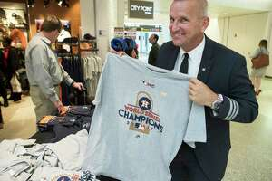 Rick Giles, an American Airlines pilot from North Carolina, shows off an Astros World Series Champions T-shirt while shopping in Terminal A at George Bush Intercontinental Airport the day after the team won the World Series.