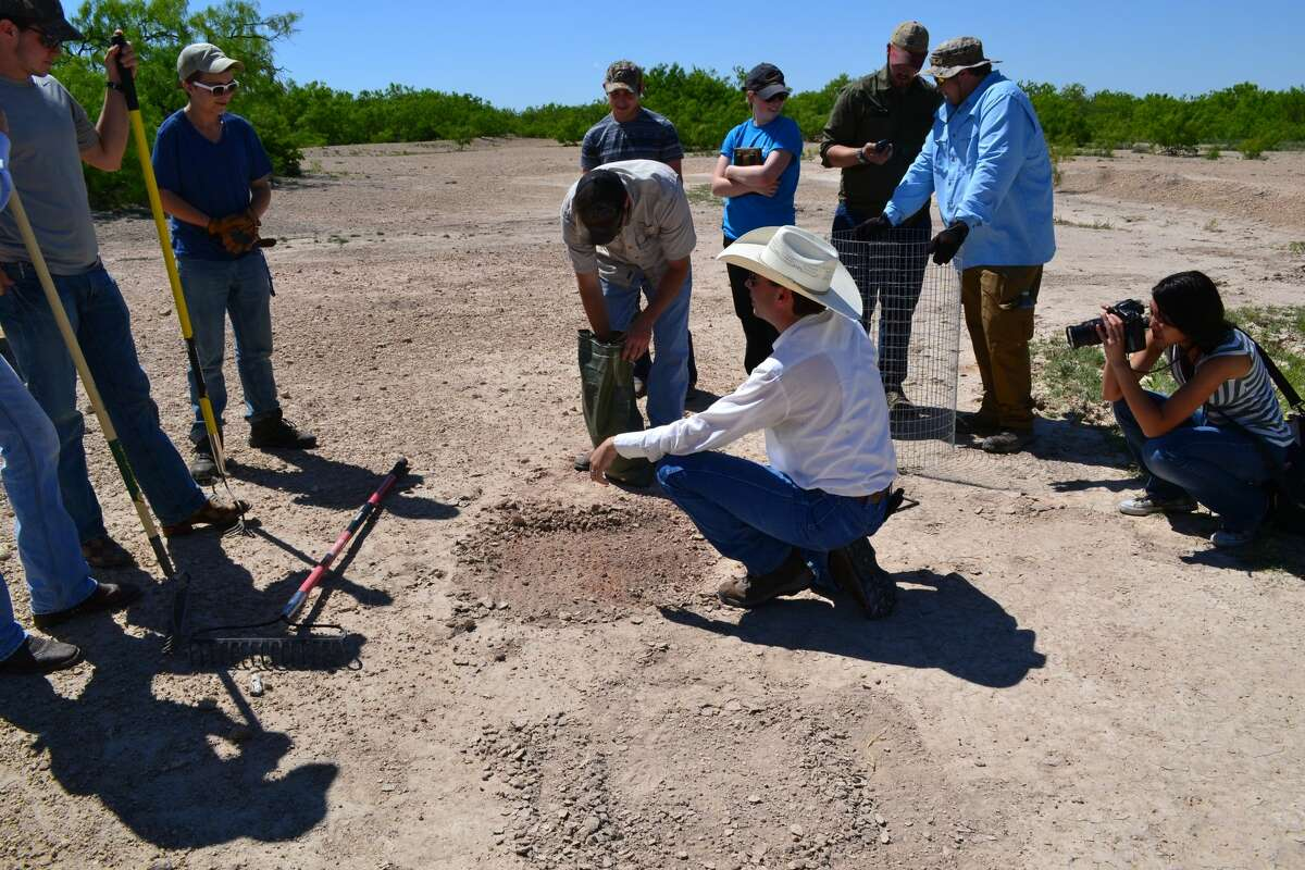 Dr. James Ward, Associate Professor of Geology in Angelo State University's Department of Physics and Geosciences, discusses soil reclamation techniques several of his students from ASU.