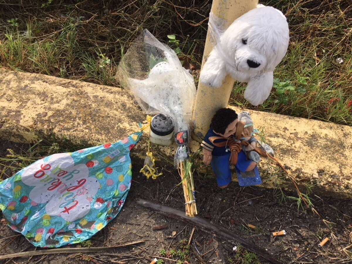 People have created a shrine on the seawall for a young boy found on the beach nearby.