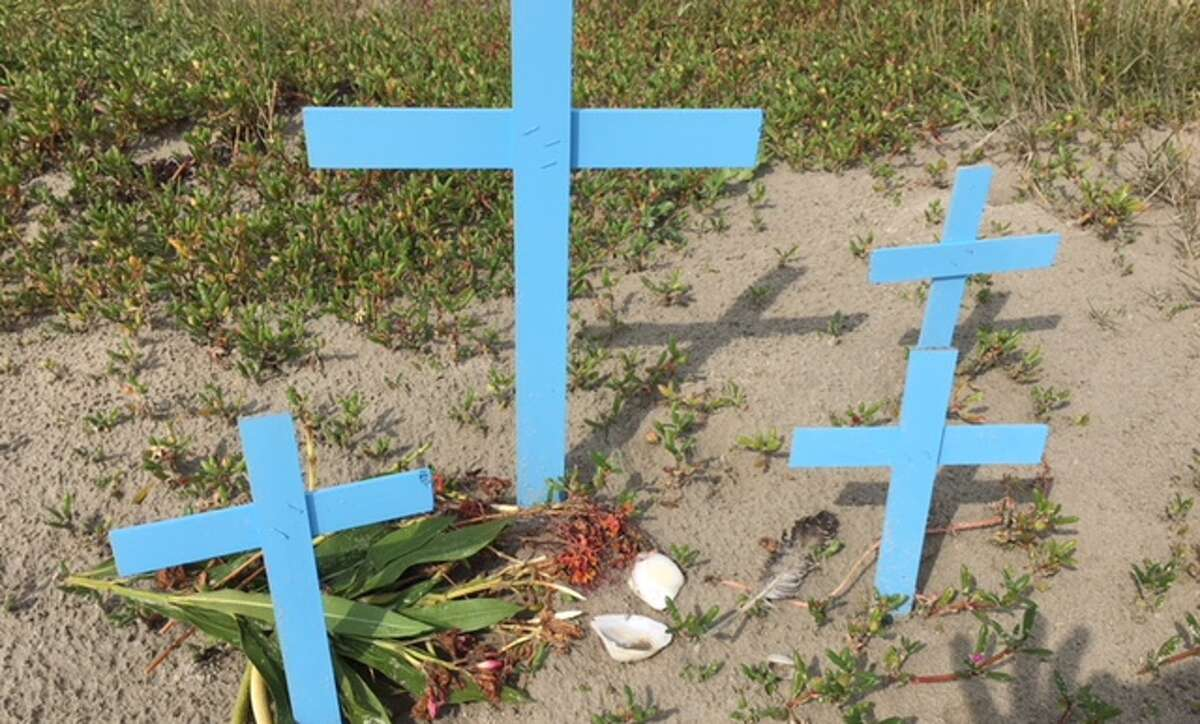 A makeshift memorial on the beach in Galveston near the spot where an unidentified boy's body was found Oct. 20.