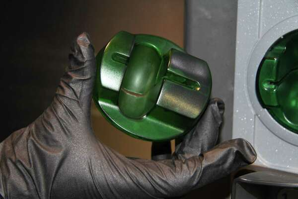 Credit card skimmers can be placed on the outside of gas pumps. This one was found by the San Antonio Police Department.