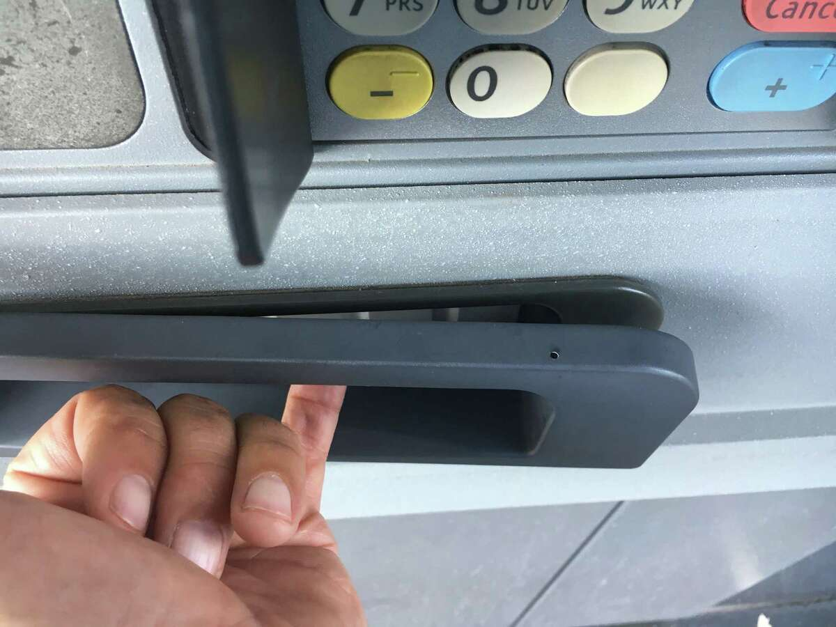 2. Check the machine for an intact security sticker. A credit card skimmer found by the San Antonio Police Department.