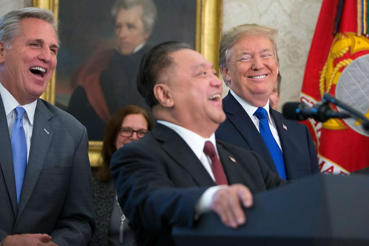 On the same day that Republican lawmakers unveiled their plan for a sweeping rewrite of the tax code, President Donald Trump and House Majority Leader Kevin McCarthy, left, laugh along with Hock Tan, chief executive of Singapore-based Broadcom, during a news conference to announce his company is moving its global headquarters to the U.S., on Capitol Hill in Washington, Nov. 2, 2017. (R-Calif.). (Tom Brenner/The New York Times)