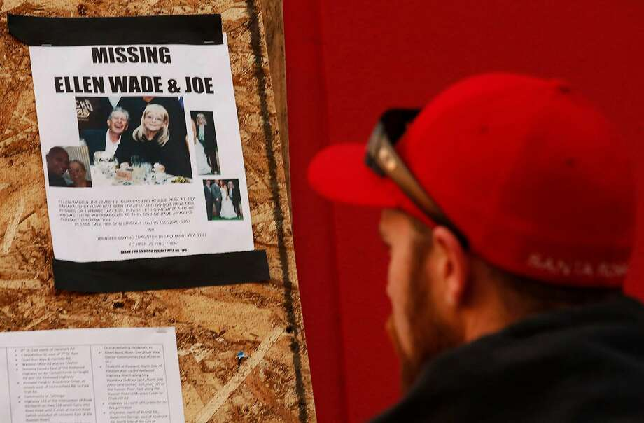 A man looks over a missing person flyer for Ellen and Joe Wade, posted on a bulletin board in front of a Target Store at the Coddingtown Mall in Santa Rosa, Calif., on October 16, 2017. Flyers have been placed throughout the city in search of people missing since the firestorm in the area. Ellen and Joe Wade, who both resided at the Journey's End Mobile Park, have since been found. The mobile home park was destroyed in the fires. (Genaro Molina/Los Angeles Times/TNS) Photo: Genaro Molina, TNS