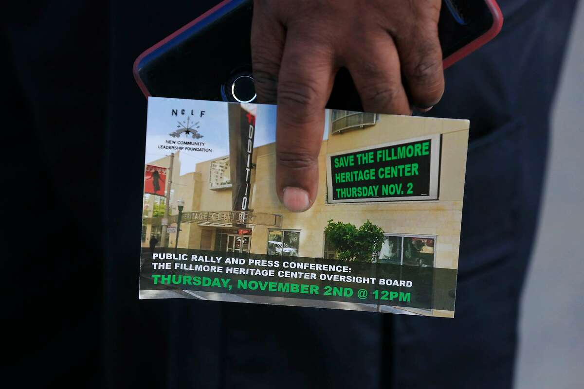Joseph Willis of San Francisco, holds a card about a public rally and press conference regarding the Fillmore Heritage Center on Thursday, November 2, 2017 in San Francisco.
