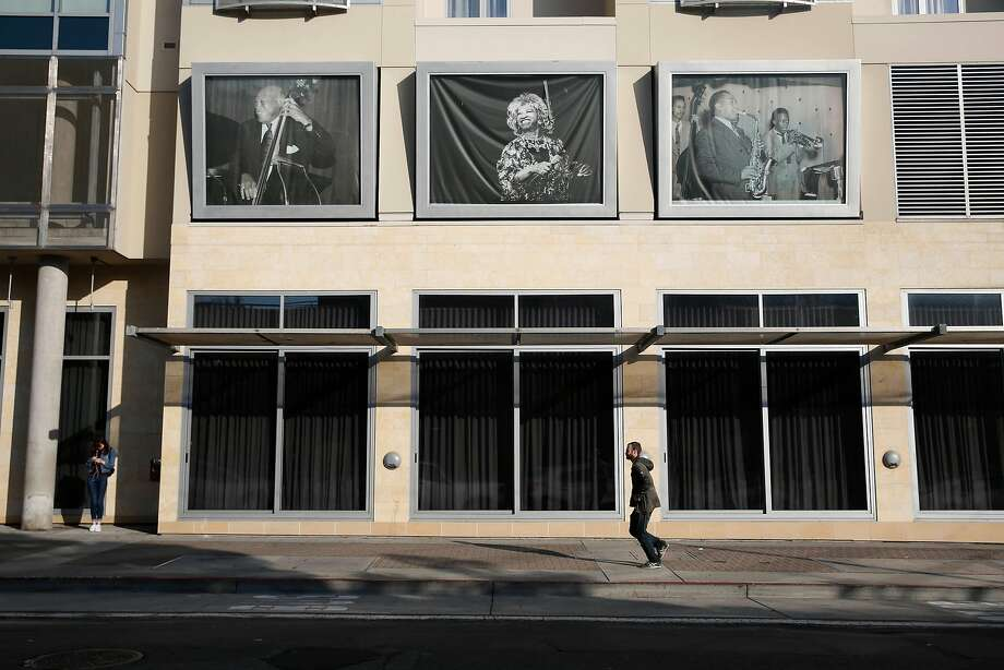 A pedestrian walks along Eddy Street past the Fillmore Heritage Center on Thursday, November 2, 2017 in San Francisco. Photo: Lea Suzuki / The Chronicle