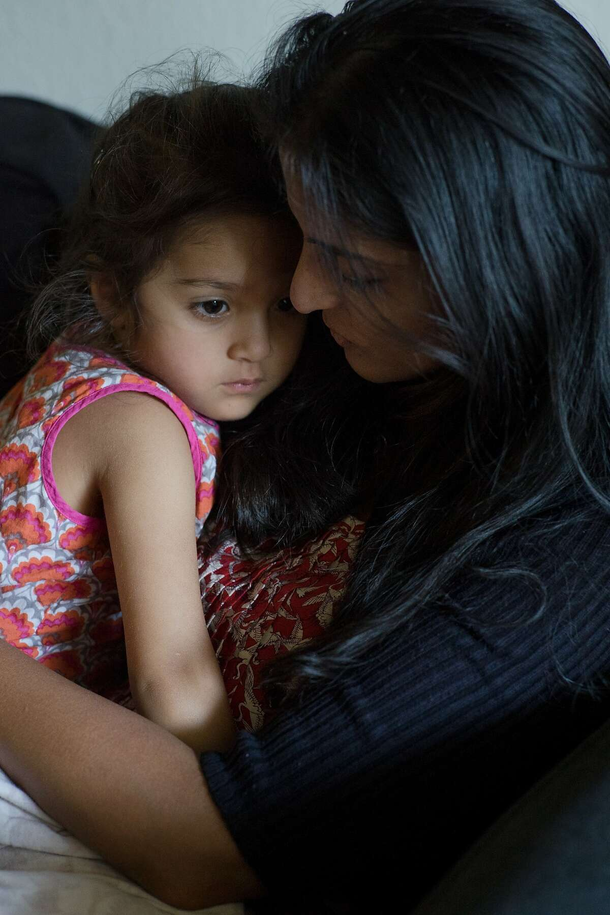 Karishma Chawla comforts her daughter Naisha at her home in San Jose, Calif. on Friday, Aug. 18, 2017. For decades spouses of H-1B visa holders could not work, until two years ago when President Obama issued a work authorization. But now his authorization is under threat by the Trump administration who is trying to rid these visa holders from the ability to work.