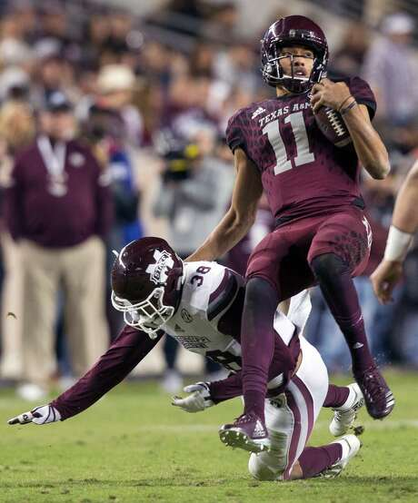 Mississippi State defensive back Johnathan Abram (38) tackles Texas A&M quarterback Kellen Mond (11) after a short gain during the third quarter of an NCAA college football game on Saturday, Oct. 28, 2017, in College Station, Texas. Photo: Sam Craft /AP Photo