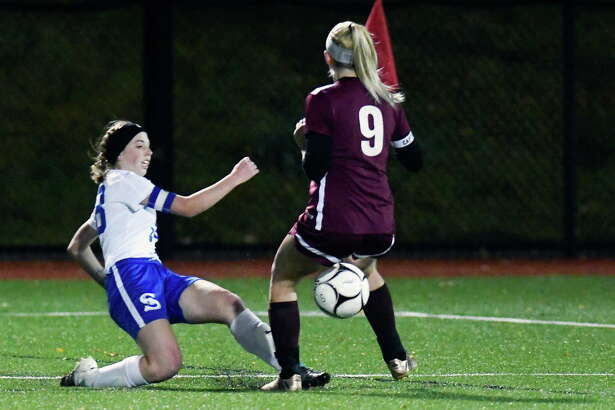 Schoharie's Maddie Phelan (18) puts the ball past Stillwater defender Faith Sheehan (9) during a girls Section II Class C high school soccer final game in Stillwater, N.Y., Wednesday, Nov. 1, 2017. Stillwater won the game 4-2.(Hans Pennink / Special to the Times Union) ORG XMIT: HP115