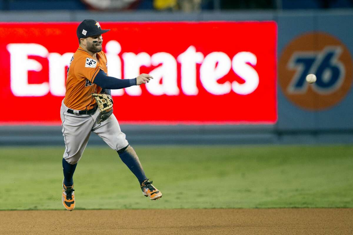 Jose Altuve #27 of the Houston Astros throws to first base for the final out of Game 7 of the 2017 World Series against the Los Angeles Dodgers at Dodger Stadium on Wednesday, November 1, 2017 in Los Angeles, California. (Photo by Rob Tringali/MLB Photos via Getty Images)