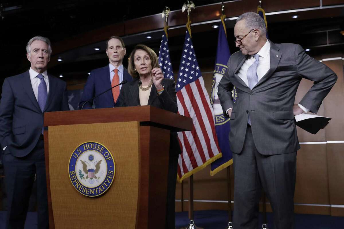 From left, Rep. Richard Neal, D-Mass., the ranking member of the Ways and Means Committee, Sen. Ron Wyden, D-Ore., the ranking member of the Senate Finance Committee, House Minority Leader Nancy Pelosi, D-Calif., and Senate Minority Leader Chuck Schumer, D-N.Y., respond to the Republican tax reform plan during a news conference on Capitol Hill in Washington, Thursday, Nov. 2, 2017.