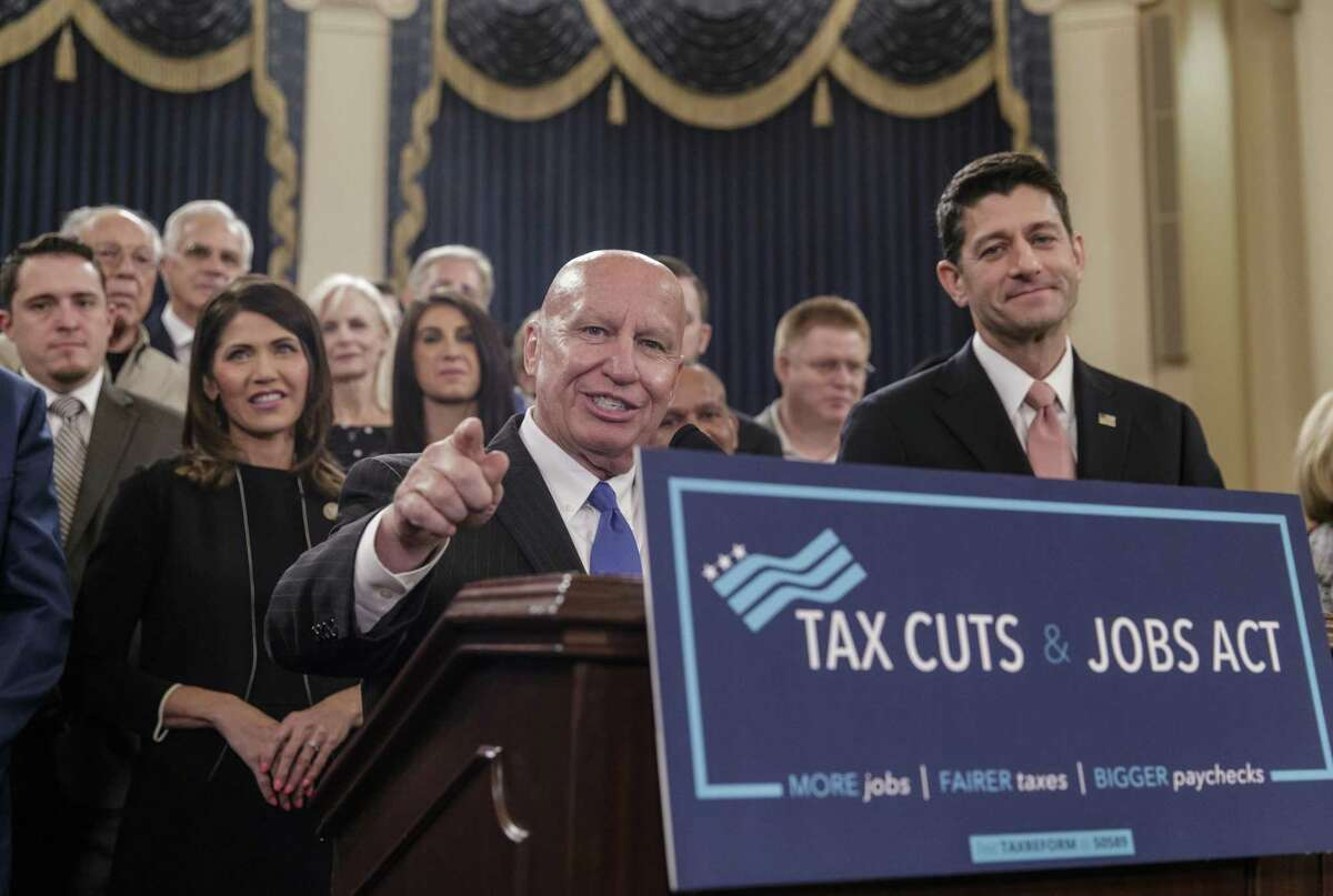 House Ways and Means Committee Chairman Kevin Brady, R-Texas, joined by Speaker of the House Paul Ryan, R-Wis., right, discusses the GOP's far-reaching tax overhaul, the first major revamp of the tax system in three decades, on Capitol Hill in Washington, Thursday, Nov. 2, 2017.