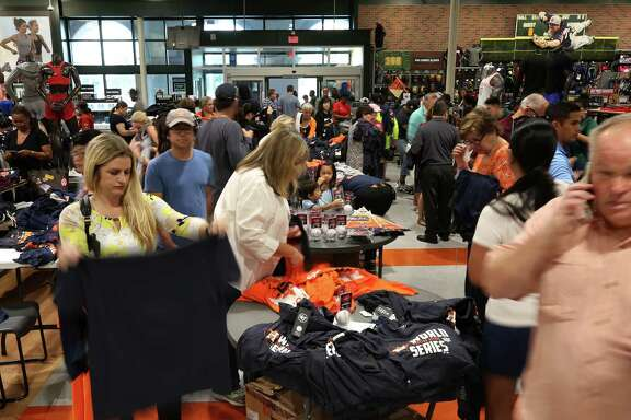 Houston Astros fans shopped for Astros merchandise at Dick's Sporting Goods after the Astros won their first World Series Championship watch party Thursday, Nov. 2, 2017, in Houston.