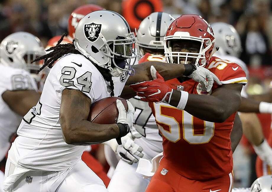 Oakland Raiders running back Marshawn Lynch (24) runs against Kansas City Chiefs outside linebacker Justin Houston (50) during the first half of an NFL football game in Oakland, Calif., Thursday, Oct. 19, 2017. (AP Photo/Marcio Jose Sanchez) Photo: Marcio Jose Sanchez, Associated Press