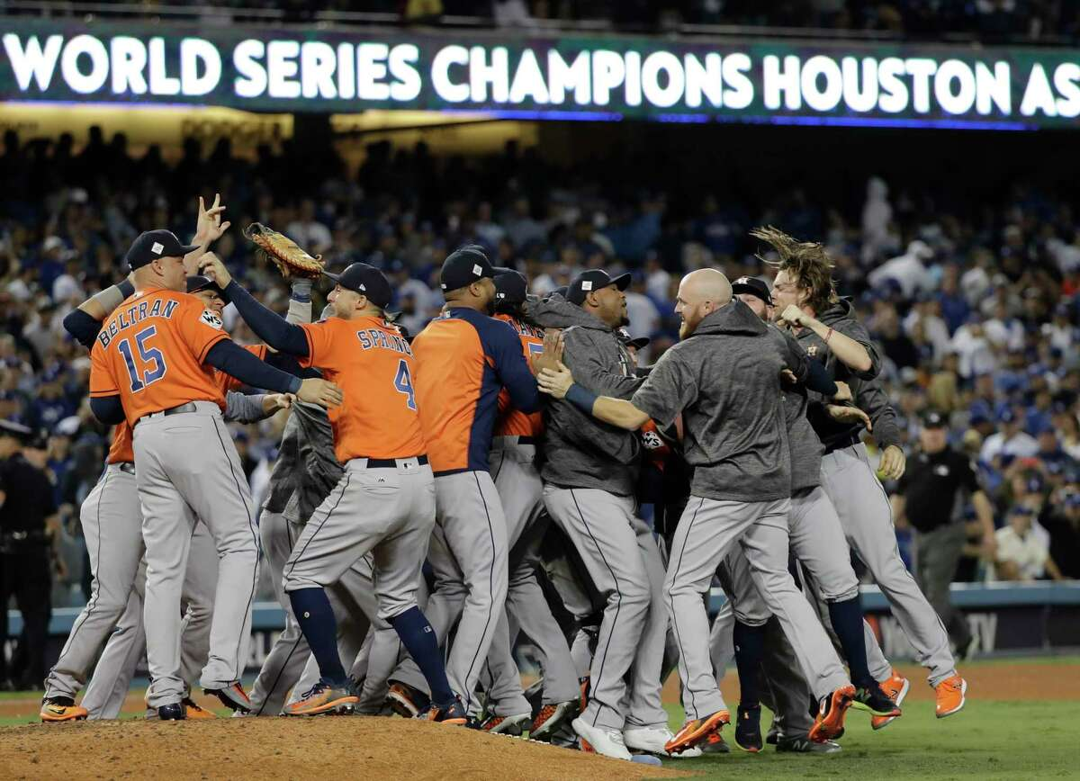 The Houston Astros celebrate after Game 7 of baseball's World Series against the Los Angeles Dodgers Wednesday in Los Angeles. The Astros won 5-1 to win the series 4-3. (AP Photo/David J. Phillip)