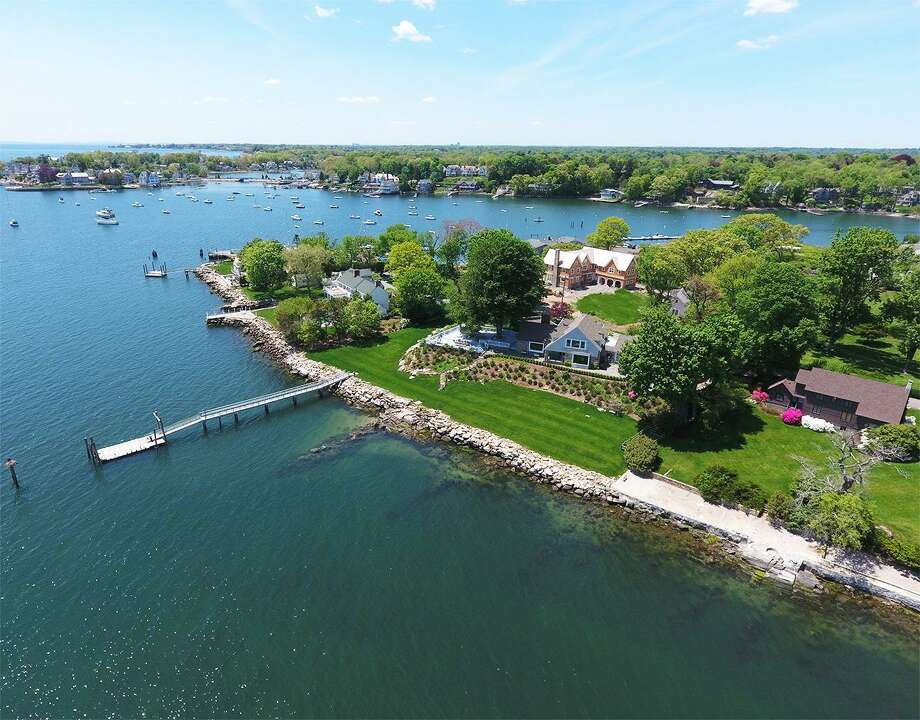 The property at 16 Nathan Hale Drive in Norwalk is up for auction through Concierge, a luxury auction firm. The recently renovated Colonial estate with 249 feet of direct waterfront in Wilson Point will sell to the highest bidder on Nov. 15, and is listed for $5.05 million through Merill Till of Houlihan Lawrence. Photo: Contributed Photo / Contributed Photo / Norwalk Hour contributed