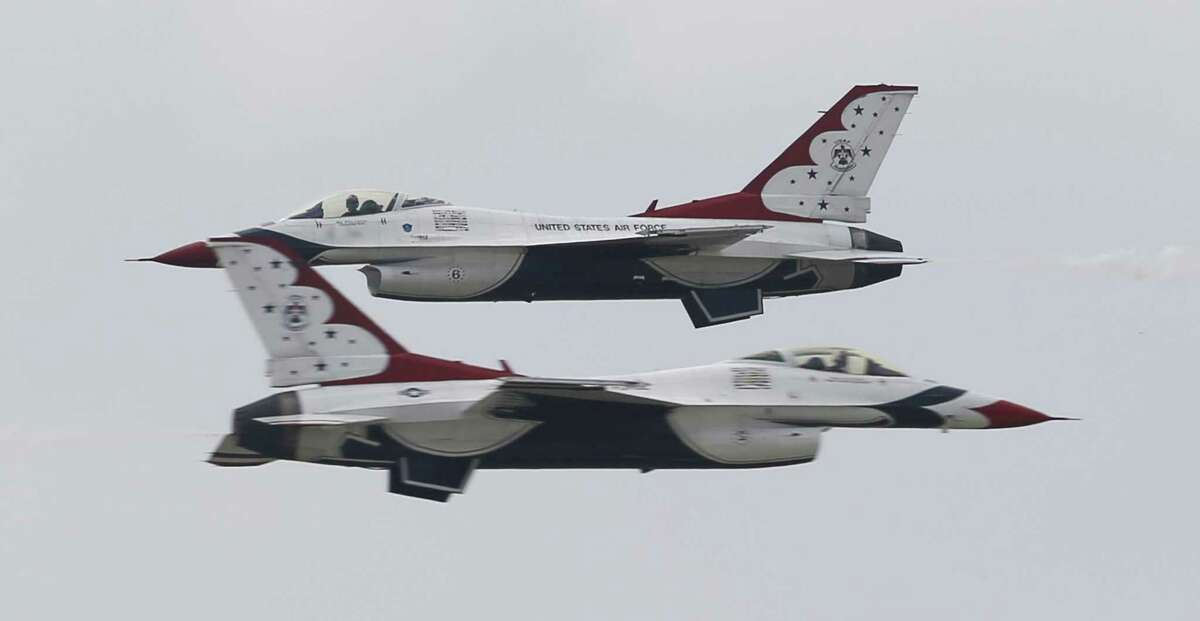 Two of the U.S. Air Force Thunderbirds zoom past one another as they make their arrival to San Antonio and Kelly Field for this weekend's JBSA Air Show and Open House 2017 on Thursday, Nov. 2, 2017. The Thunderbirds roared above the airfield's skies, one of the show's marquee performers. The show kicks off on Saturday to the public with static displays of various military aircraft from history to modern day. Several aerial demonstrations will take place along with the Thunderbirds. (Kin Man Hui/San Antonio Express-News)