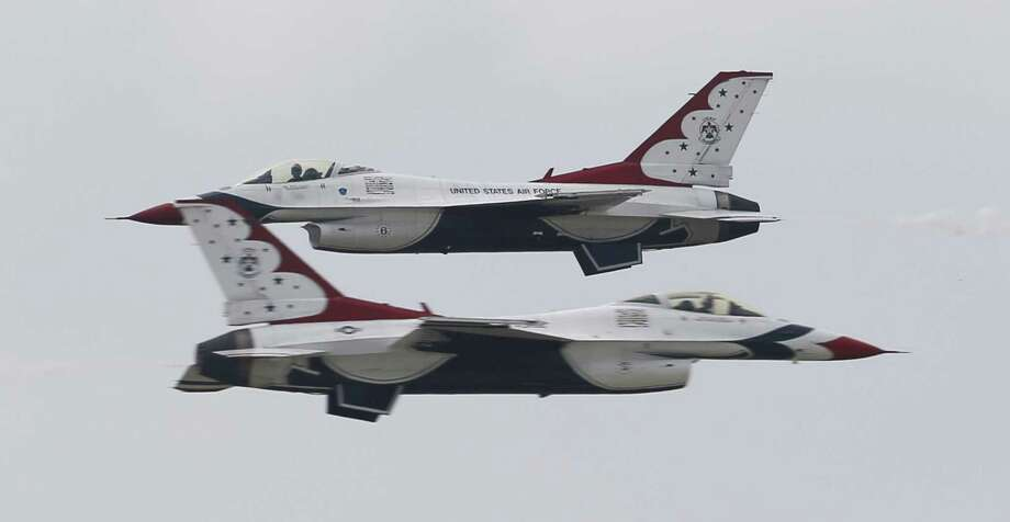 Two of the U.S. Air Force Thunderbirds zoom past one another as they make their arrival to San Antonio and Kelly Field for this weekend's JBSA Air Show and Open House 2017 on Thursday, Nov. 2, 2017. The Thunderbirds roared above the airfield's skies, one of the show's marquee performers. The show kicks off on Saturday to the public with static displays of various military aircraft from history to modern day. Several aerial demonstrations will take place along with the Thunderbirds. (Kin Man Hui/San Antonio Express-News) Photo: Kin Man Hui /San Antonio Express-News / ©2017 San Antonio Express-News